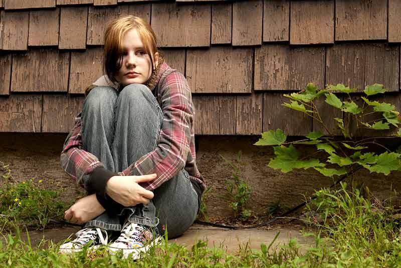 Teen girl alone