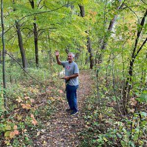 Gary in the woods, waving